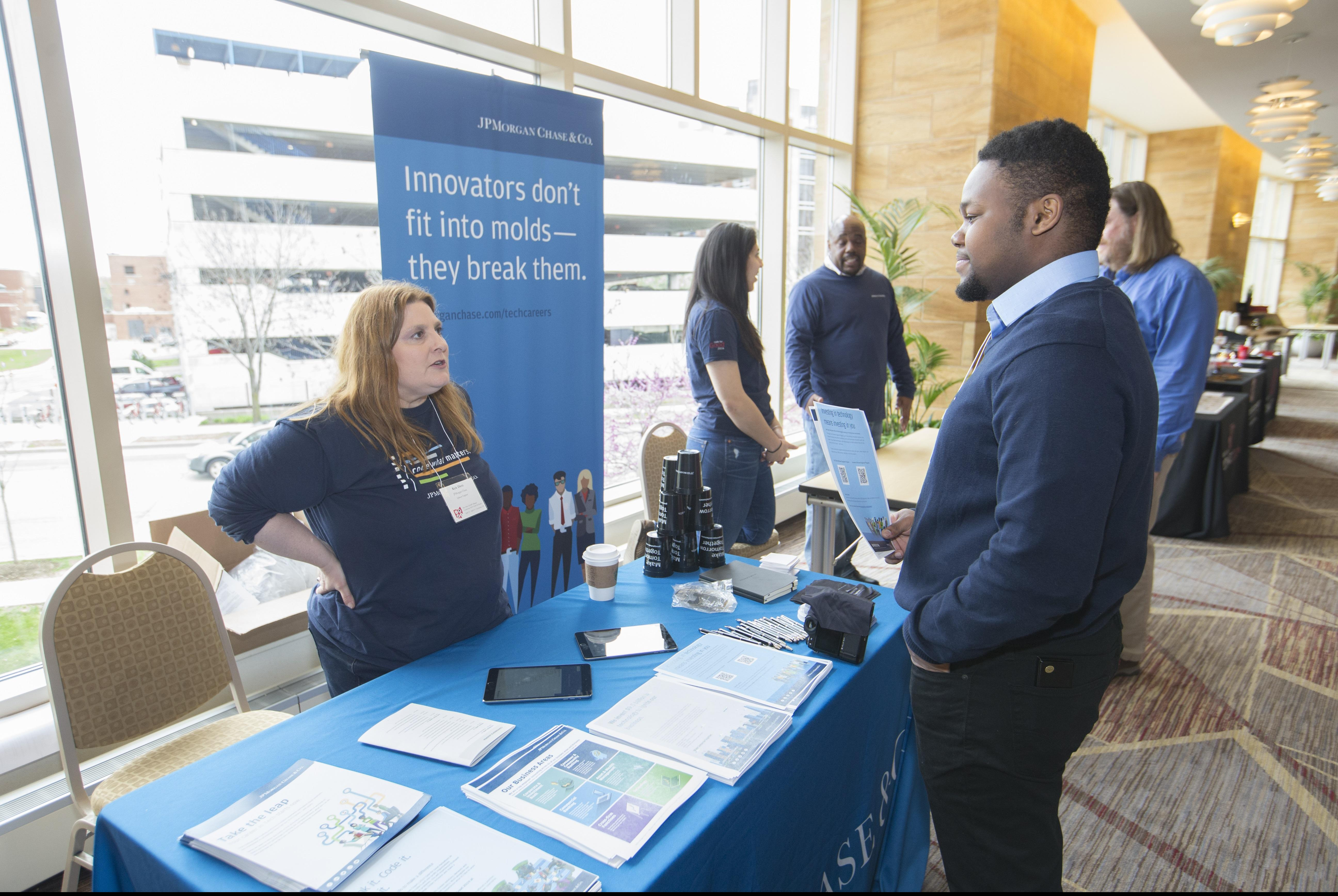 Industry Recruiter speaking to student conference attendee.