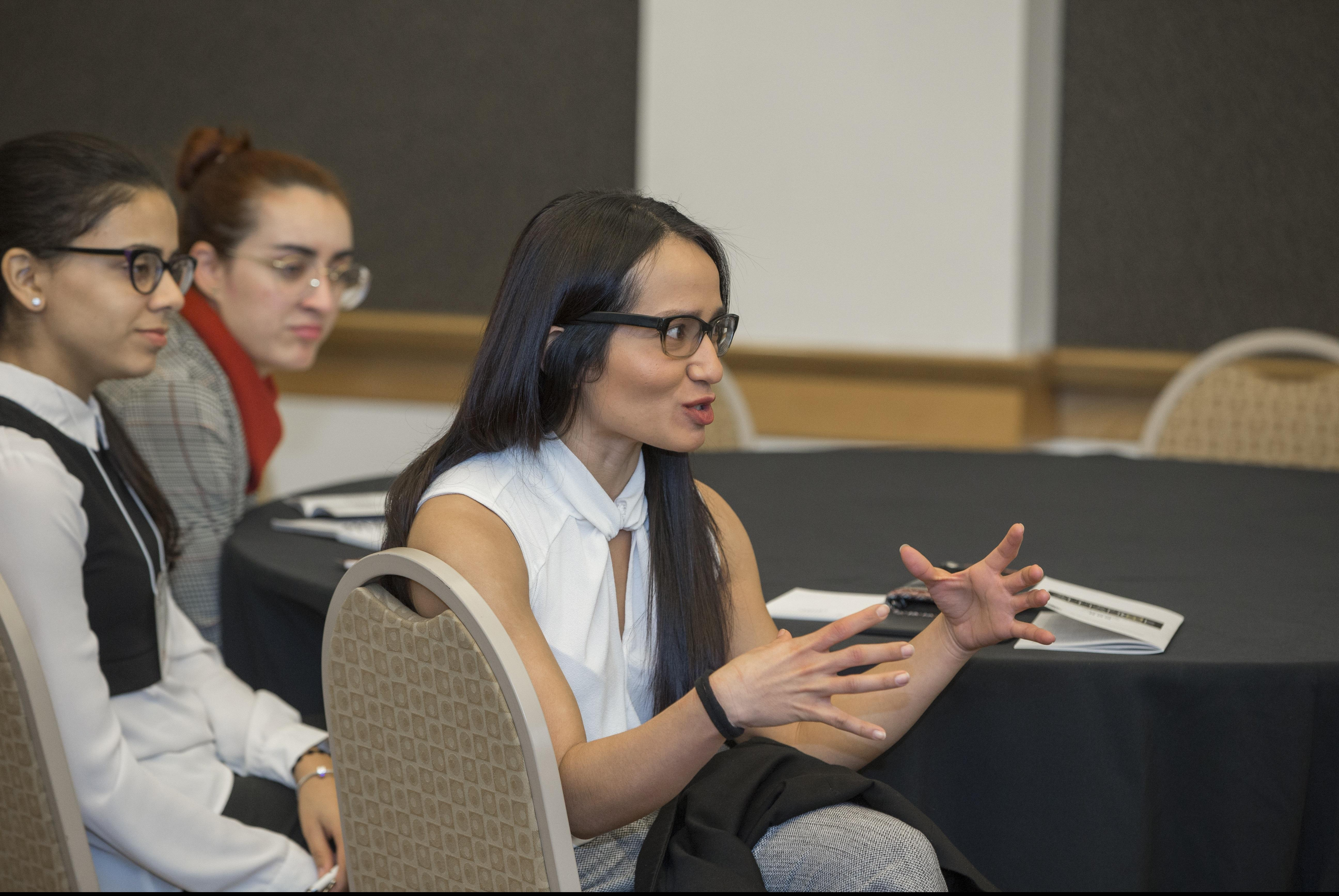 Student conference attendee speaking with facilitator.